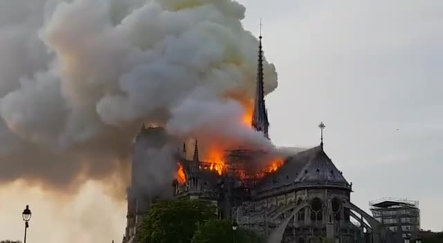 Notre-Dame Cathedral burns. Smoke and fire is seen leaping from the top of Notre Dame, the iconic Paris cathedral. Videos shot by people show the blaze engulfin