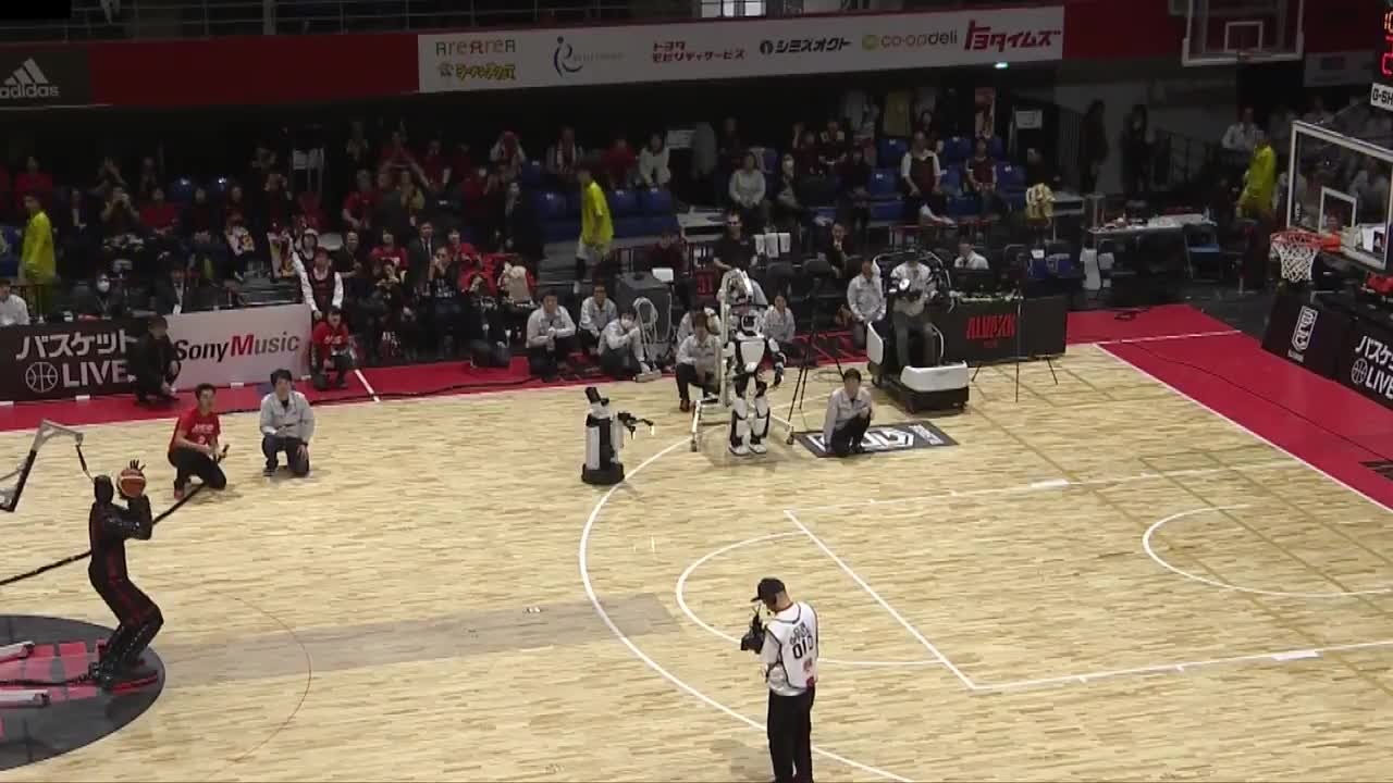 ROBOT SPORTS WHEN. .. It can play basketball good. Of course they made it black!