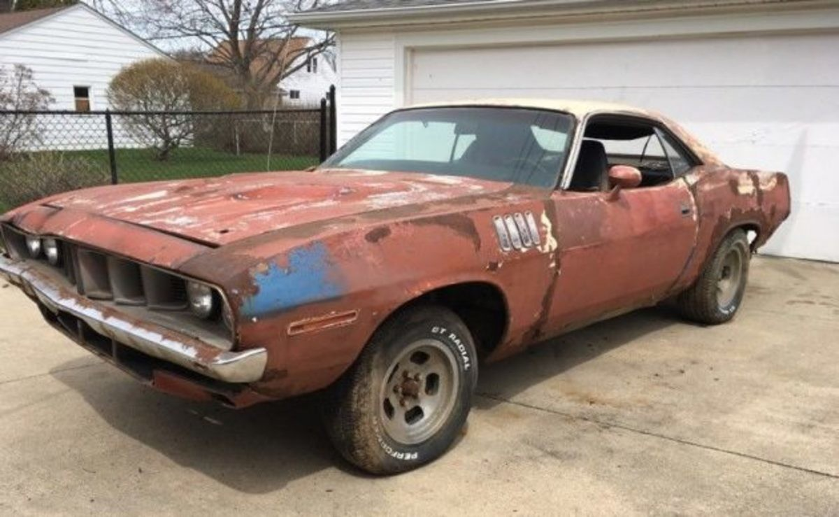 1971 Plymouth Barracuda. .. If you get that sand blasted you will have a realy nice pile of sand