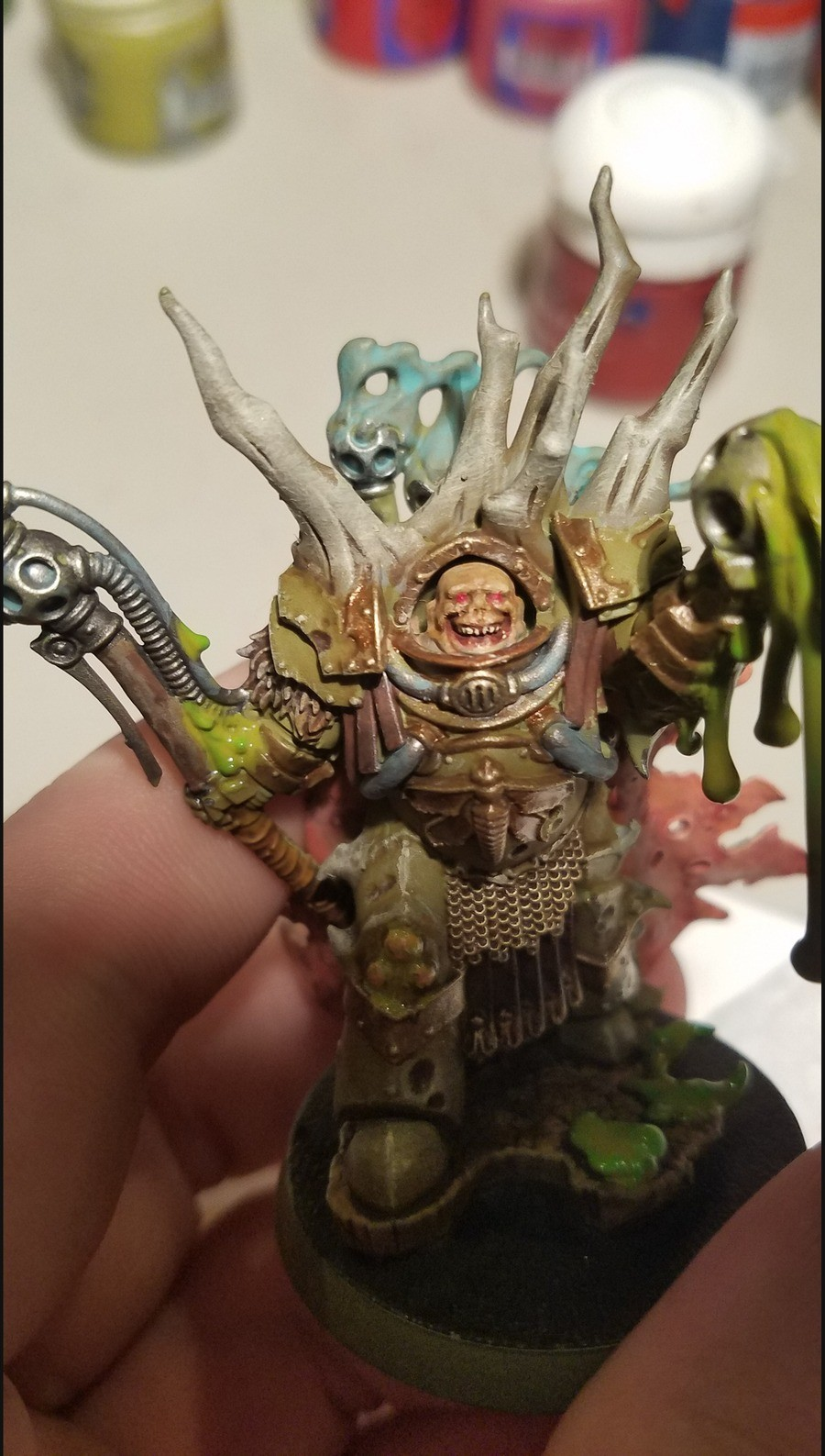 Any love for this happy sumbitch?. I just finished painting him recently, and I'm pretty proud. 3rd times the charm, folks. Kept rotating on me...... glory to grandpa Nurgle for this lovely painting