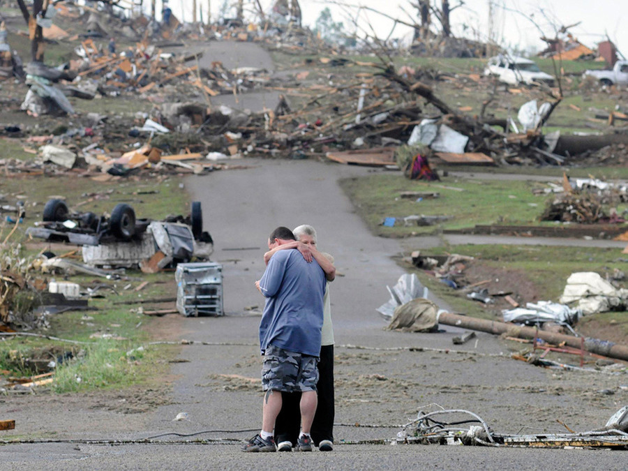 Breathtaking photos 26. A mother comforts her son in Concord, Alabama, near his house which was completely destroyed by a tornado in April of 2011 A river runni