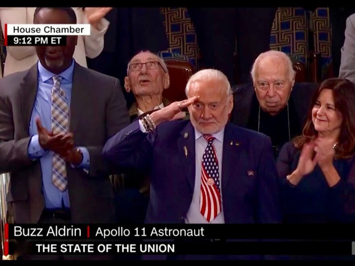 Buzz Mothering Aldrin. All the other stuff from the State of the Union aside, Buzz Aldrin is 90 years old and looks fantastic... I love the statement with the tie. Anti-patriotic anti-American Hollywood won't display USA flag in the movie, but Buzz Aldrin got us covered!