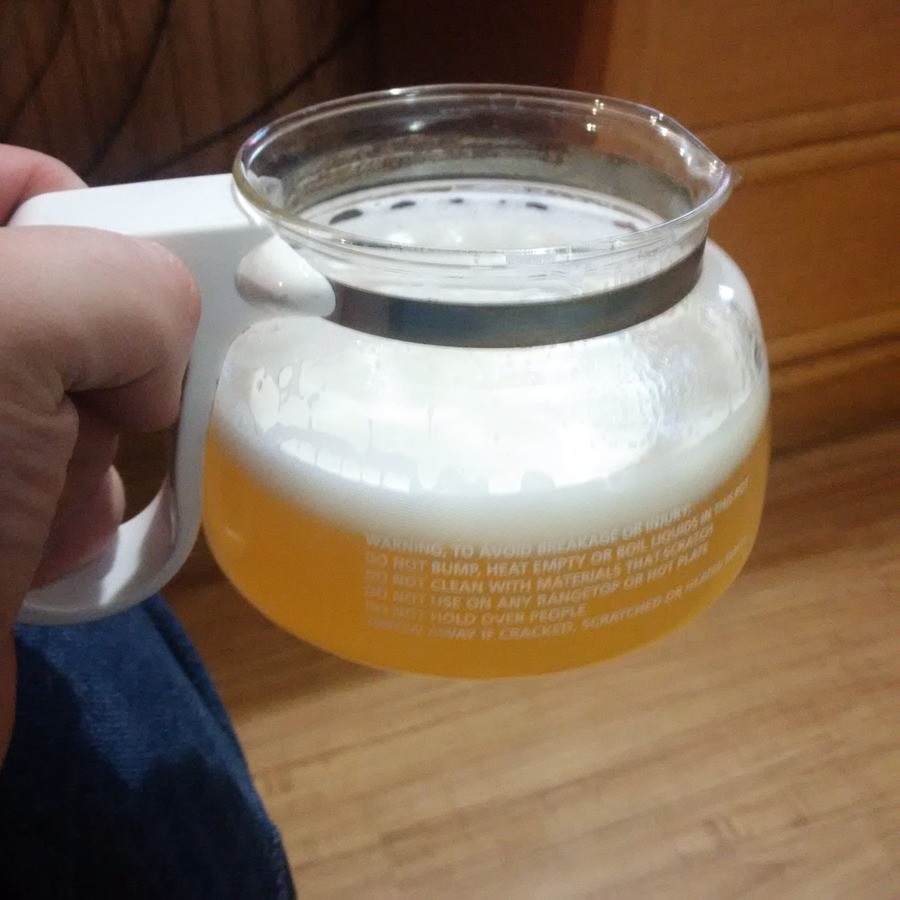 Good morning!. I like my beer to breathe, so I improvised. Before you ask, yes, the motel I'm staying in has a coffee pot, but no mugs. I don't know why... Looks like a piss jug .