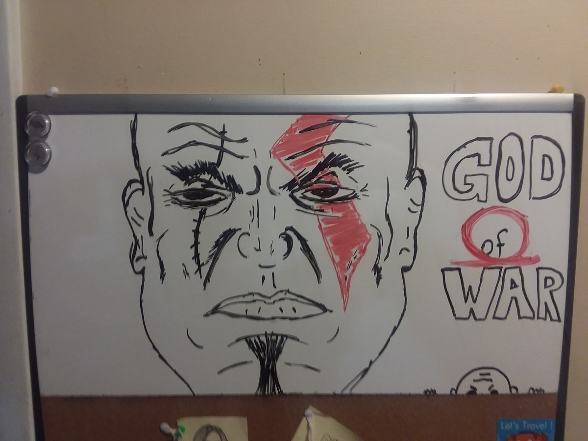 Kratos. Love the new god of war. Decided to draw Kratos on the house white board... looks like celo green