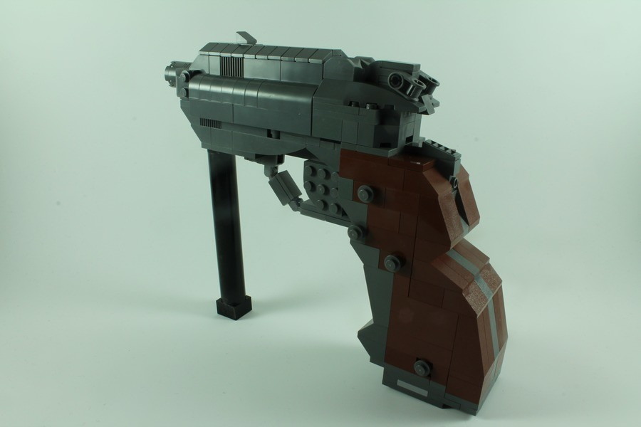 """LEGO Security Pistol (DOOM 3). (more pictures can be found here: http://www.moc-pages.com/moc.php/432501)..  """"HAH YOU DONT HAVE THE GUTS TO PULL THE TRIGGER""""  """"Woah ok buddy please calm down I was joking please I"""