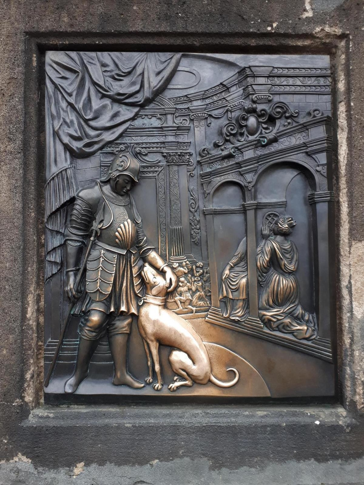 Prague. .. the dog is supposed to bring you luck if you touch it. so everyone touches it which is why its shiny and gold. its on the charles bridge.